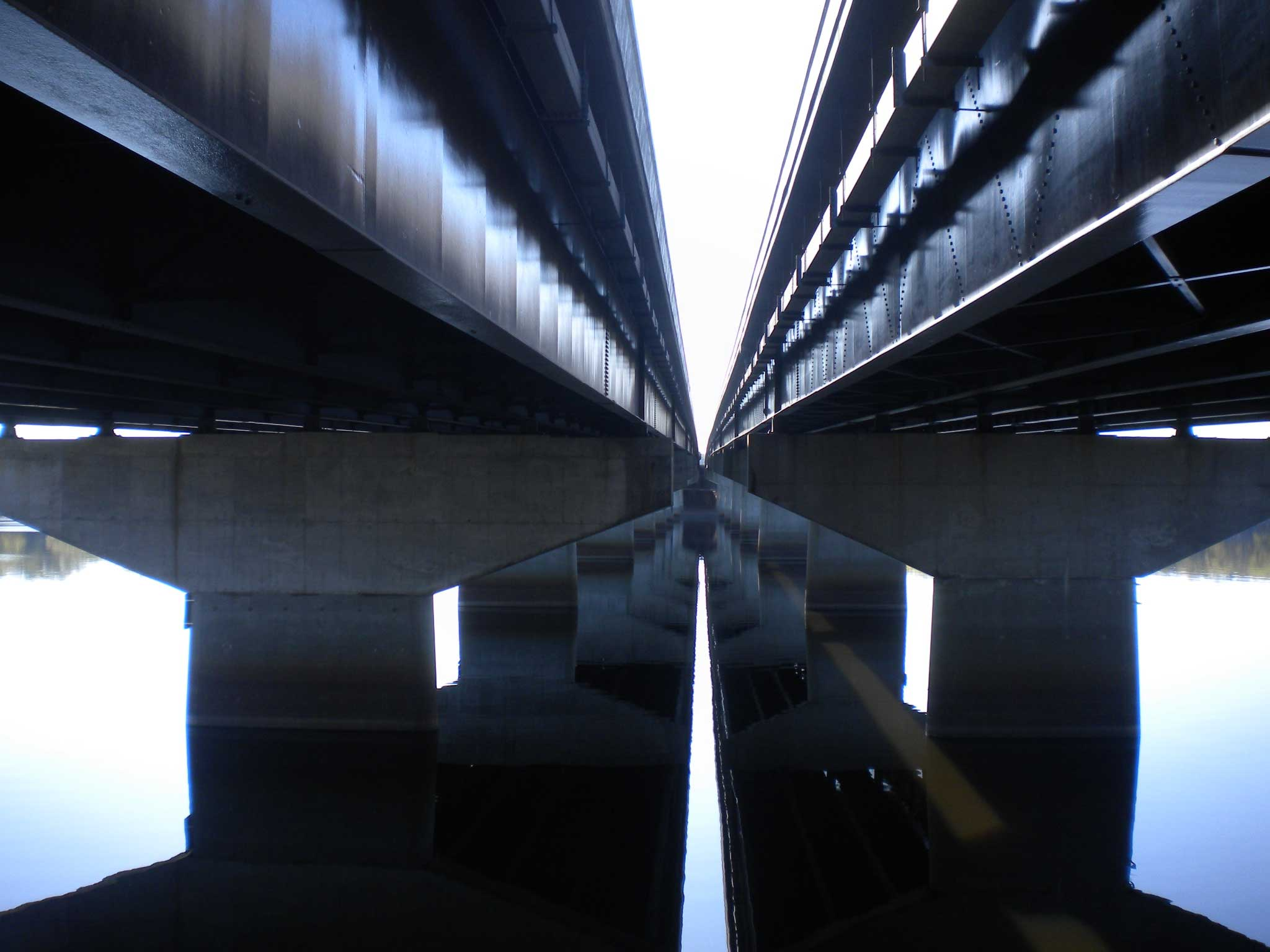A vanishing point between parallel viaducts and their reflections in Minnesota.