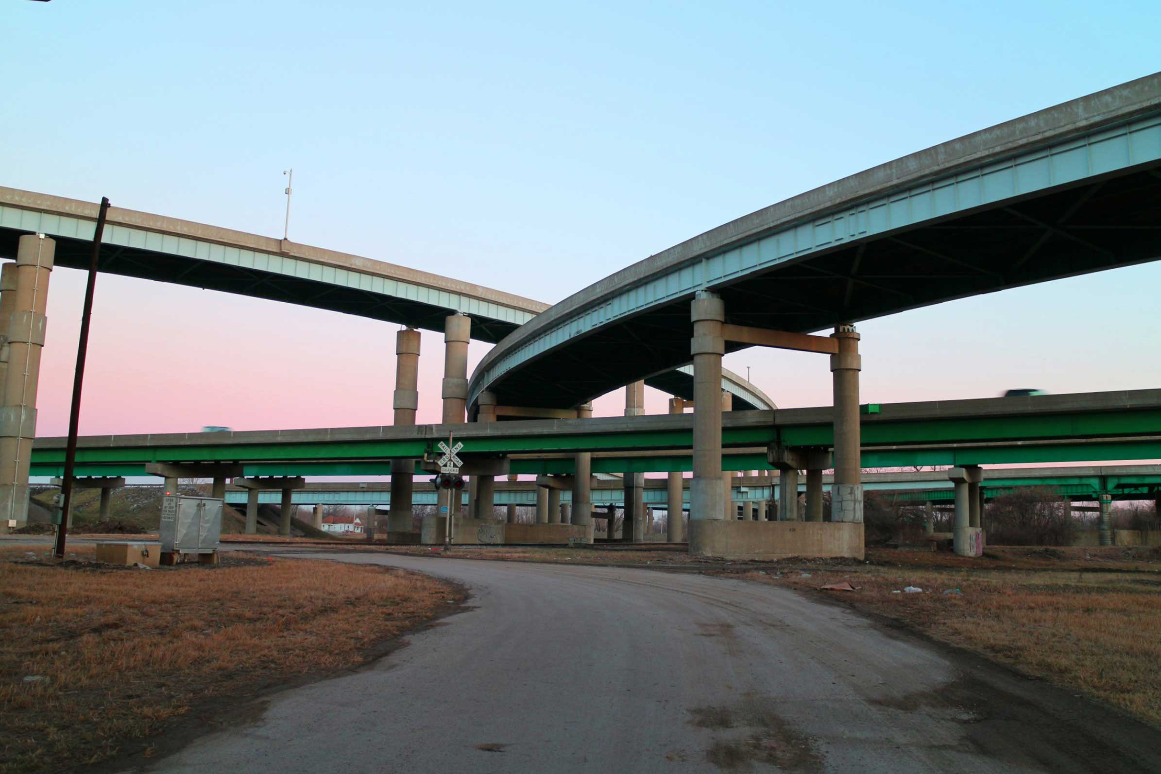 A pink dusk behind a highway interchange outside of St Louis, Missouri.